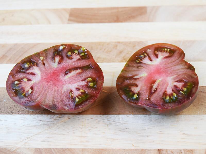 pink berkeley tie dye tomato cut open inside